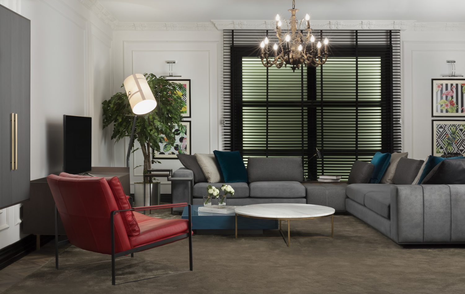 Corner modular sofa with round coffee table and leather lounge chair